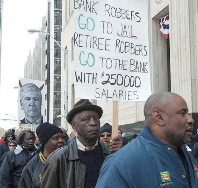 Protest during bankruptcy hearing in Detroit as Mich. Gov. Rick Snyder testifies