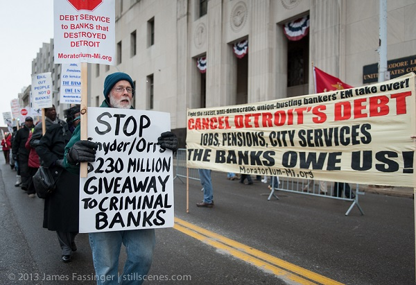Unions and community groups protest outside Detroit bankruptcy court.