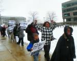 "Detroiters March In Cleveland, Tell Jones Day ""GET OUT"""